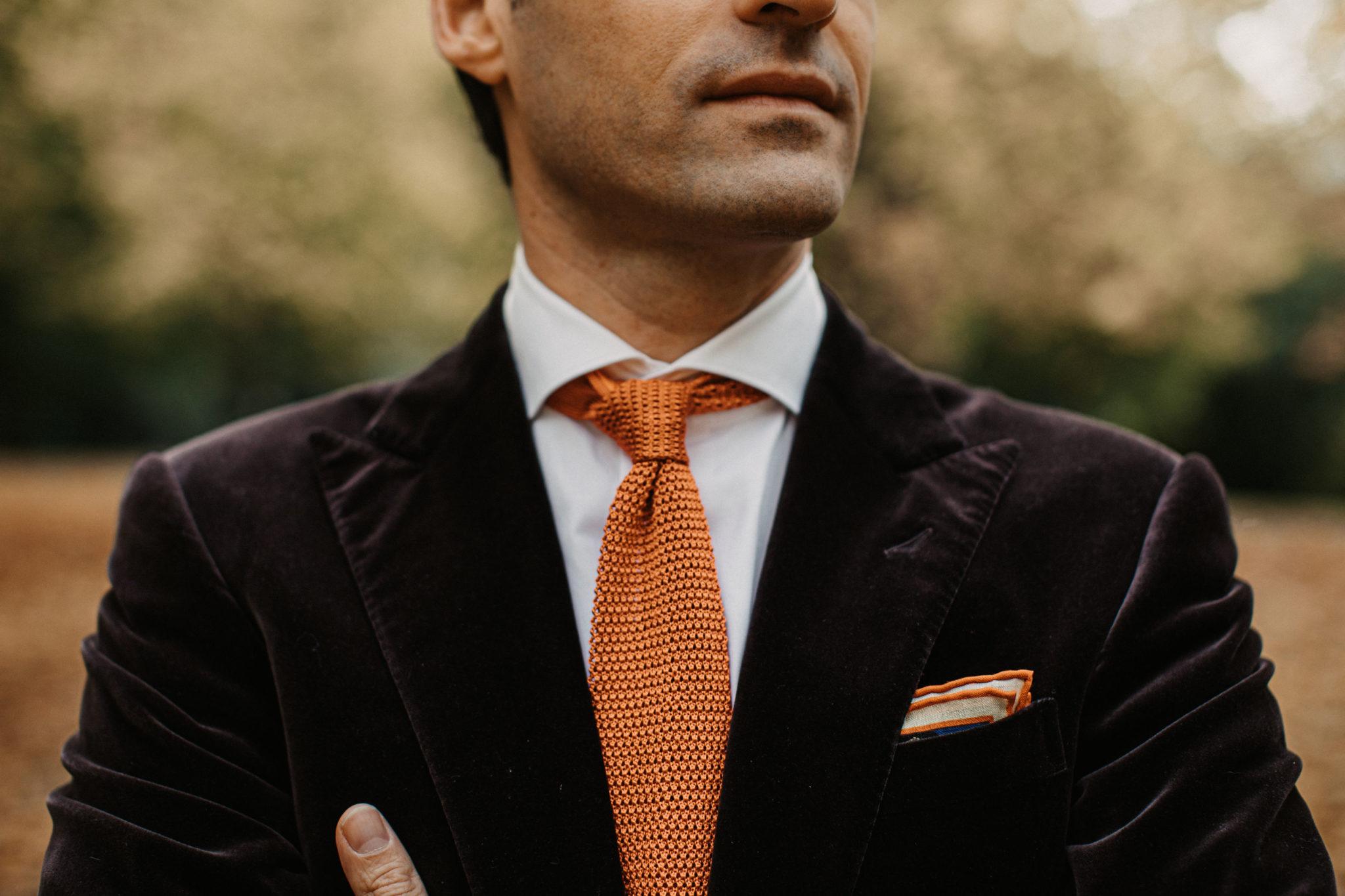 Detail of Dalbiondo Tailoring custom white shirt, rust knit tie and velvet jacket's lapels