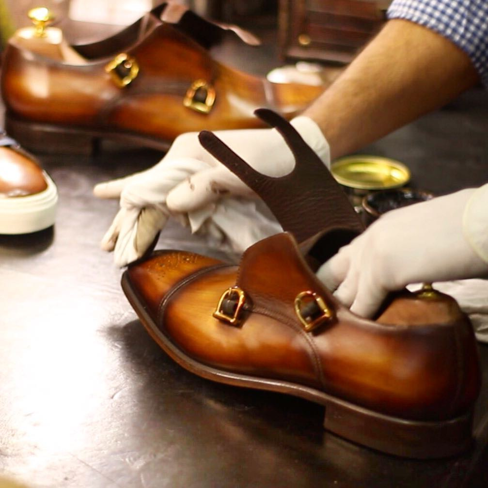 Hand Finishing the upper leather on Dalbiondo shoes