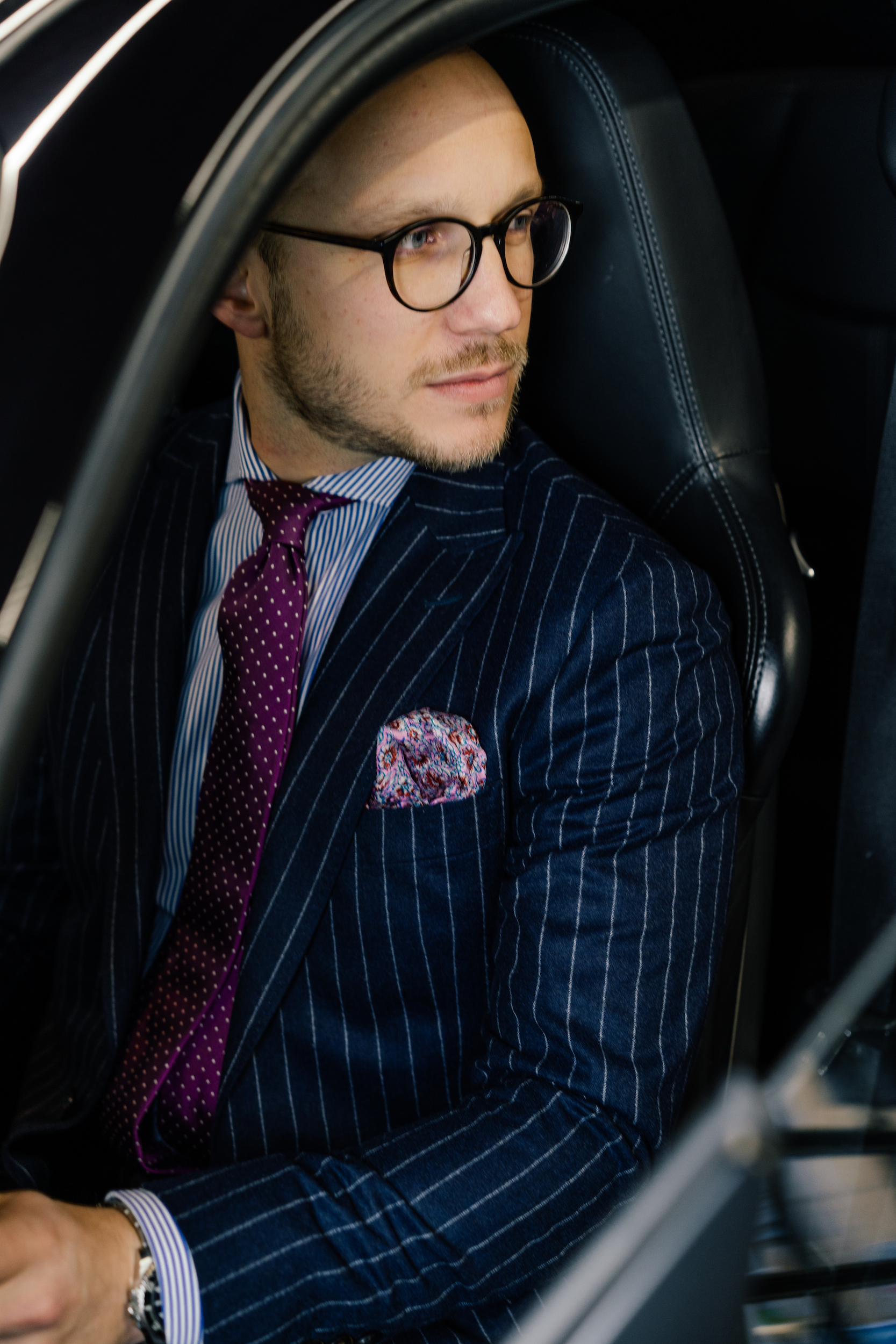 Man wearing made to measure Dalbiondo pinstripe flannel suit.