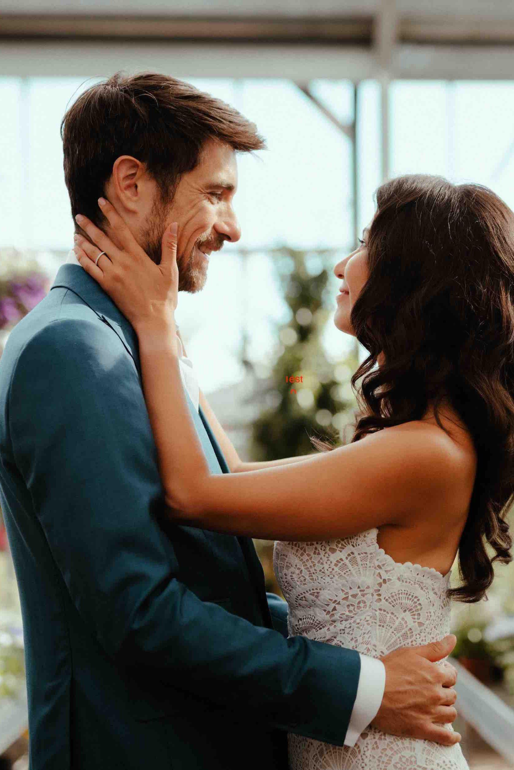 Groom in a Dalbiondo wedding attire with his bride