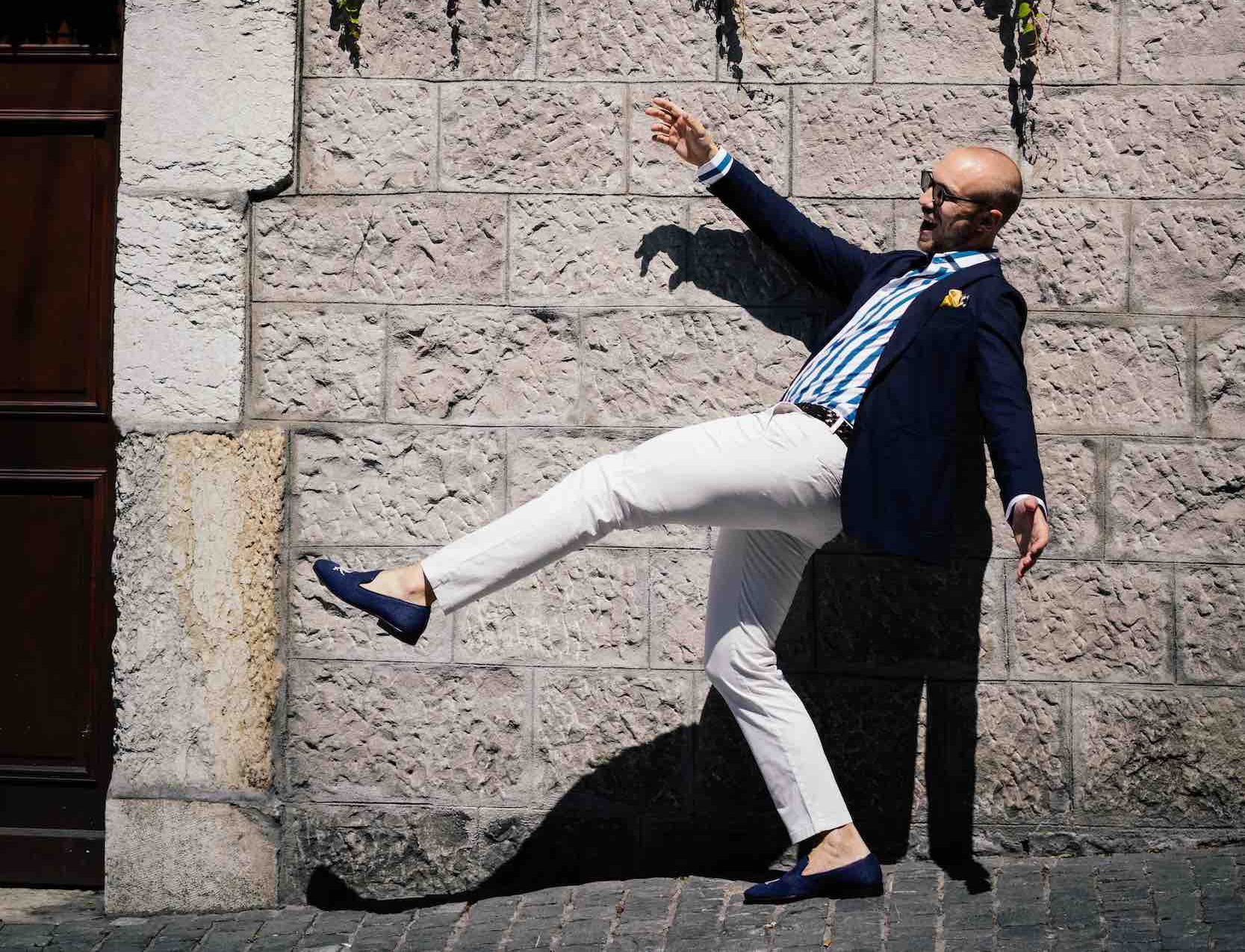 Man it total custom look by Dalbiondo Tailoring: navy unconstructed blazer, wide-stripe handmade shirt, off-white trousers and handmade linen slippers.