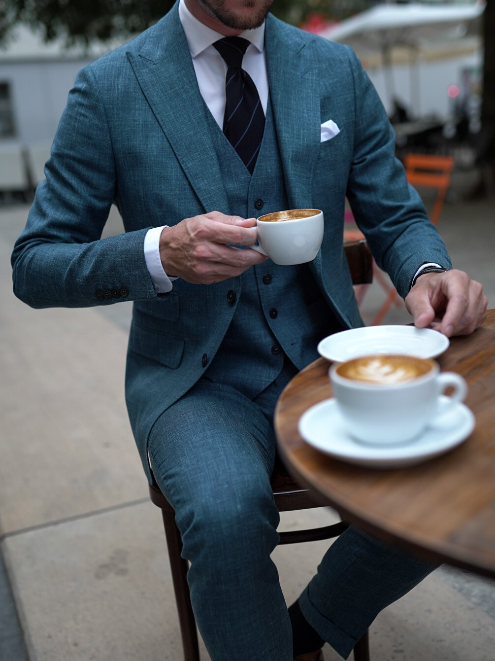 Man with Dalbiondo custom made suit in striped linen and silk