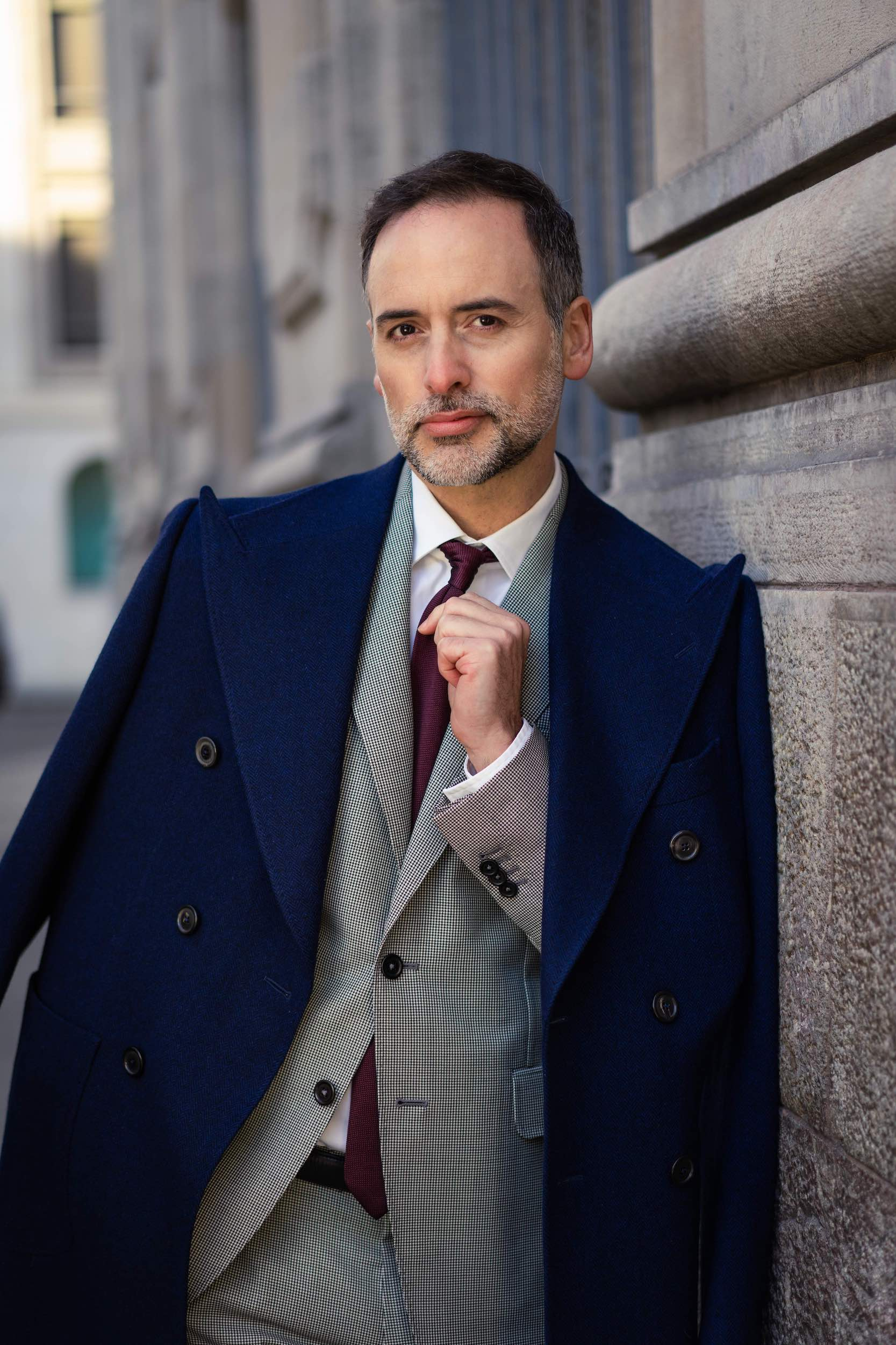 Man wearing a full Dalbiondo custom outfit: made to measure overcoat, suit, shirt and tie